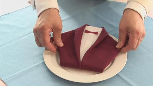 http://www.videojug.com/film/how-to-fold-a-dinner-jacket-napkin